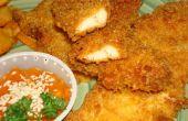 Krokante vochtige kip vingers met gepaneerd friet en saus