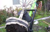 Planten van een boom met een gigantische twee wiel Dolly
