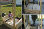 Zand vak w / deksel dat wordt geopend in de bench en een luifel