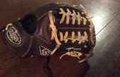 Breken In een honkbal handschoen