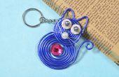Hoe maak je leuke sleutelhangers met blauwe draad gewikkeld kat hanger