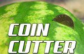 Hoe te knippen een watermeloen in tweeën met een munt