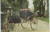 Verkeer-waarschuwing fiets aanhangwagen gemaakt van een ongewenste fiets