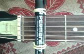 Een goedkope gitaar capo