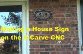 Maken van een houten huis teken op CNC