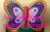 Kinderen bouwen - Hand een keramische vlinder kleuren