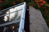 Montage van meerdere zonnepanelen met behulp van oude venster blind rails en hardware