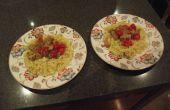 Pikant varkensvlees en tomaten met romige Pasta