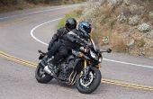 Ze veilig als een passagier van de bijrijder op een motorfiets.