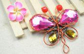 Wire Wrapping sieraden Tutorial over het maken van een Vintage vlinder broche met parels