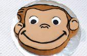 Een nieuwsgierige George taart maken