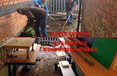 Afval van de grond naar IRL houtbewerking gebied