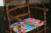 Vernieuwde schommelstoel met hergebruikt insect scherm linten.