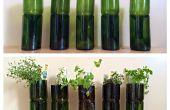 Upcycled wijn flessen in overdekte kruid plantenbakken
