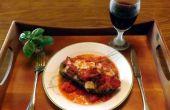 AUBERGINE gevuld met GRUYERE kaas, champignons, PAPRIKA en uien & gebakken IN een saus van rode wijn CLAM