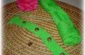 Hoe te breien een geribde knoopbies voor een trui of vest