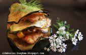 Gebakken groenten en vis filets stapels gepaneerd