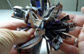 Geurende Gift boog gemaakt van gerecycled parfum advertenties