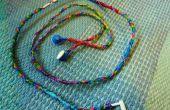 Hoe maak je oordopjes kleurrijke met behulp van draad