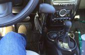 Besturen van een auto met Menox hand besturingselementen