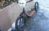 Zet een oude fiets van de kinderen in een fiets gehakte kick