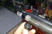 Knop met pulsdrukschakelaar vervangen geweer Laser